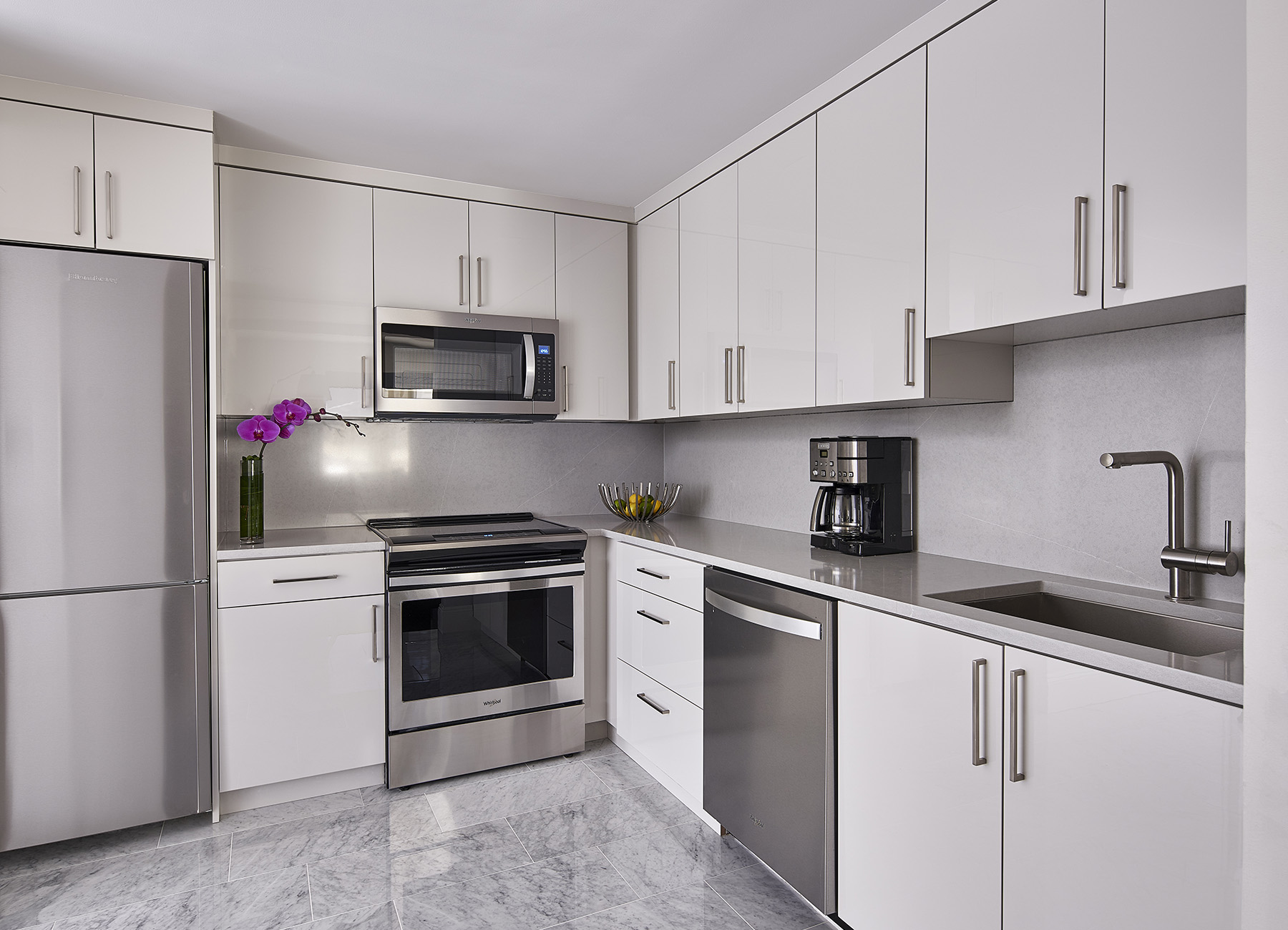 AKA Central Park kitchen with white countertops and full sized appliances