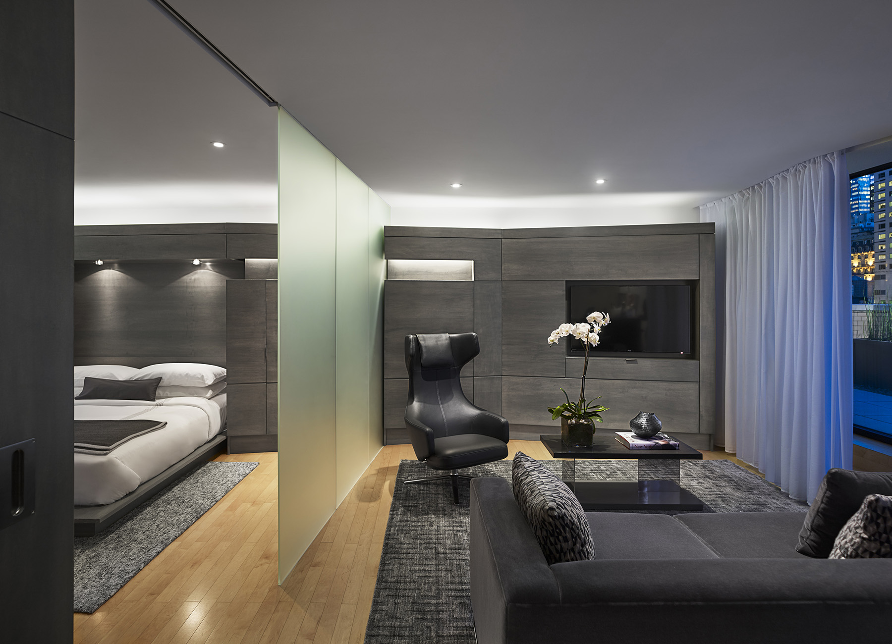 AKA Central Park sky suite with modern bedroom furniture and living room space