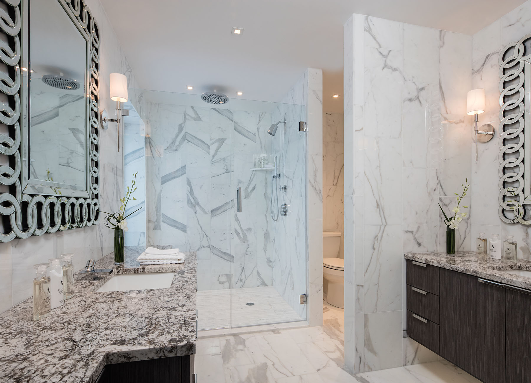 AKA Sutton Place bathroom with marble finishes and large shower