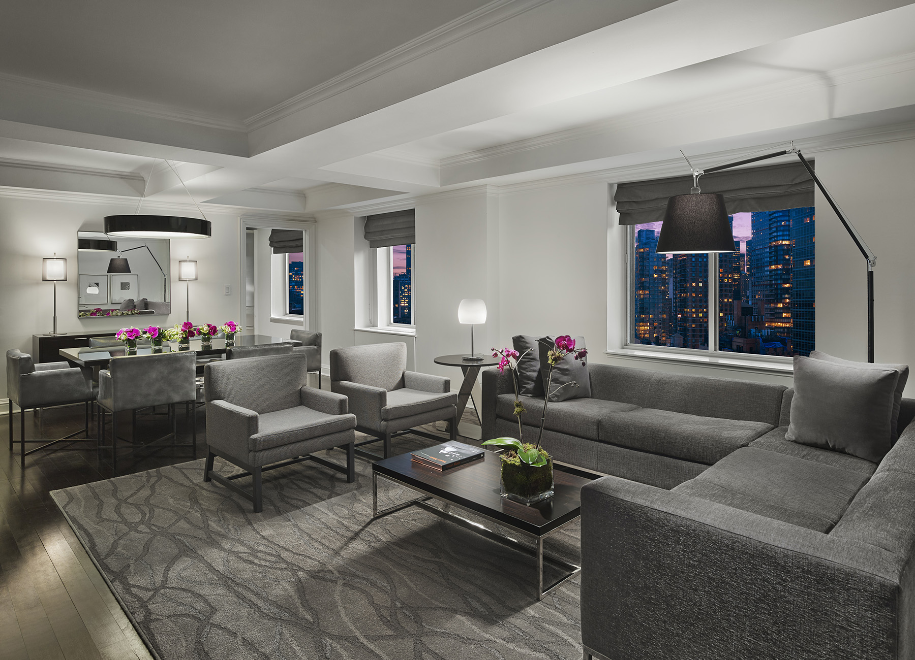 AKA Sutton Place Penthouse Living room with gray couch and chairs