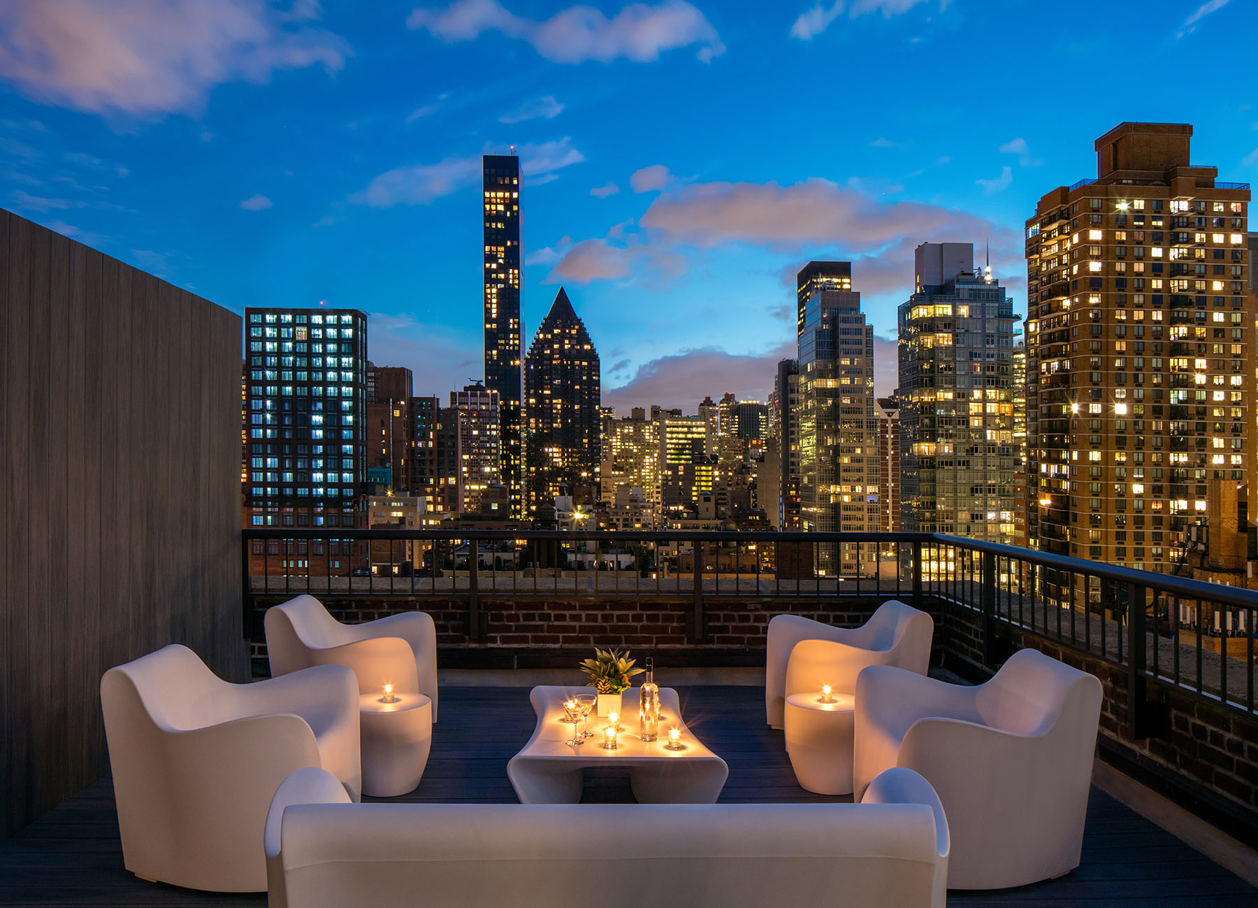 AKA Sutton Place exterior patio for penthouse at dusk with views of the NYC skyline