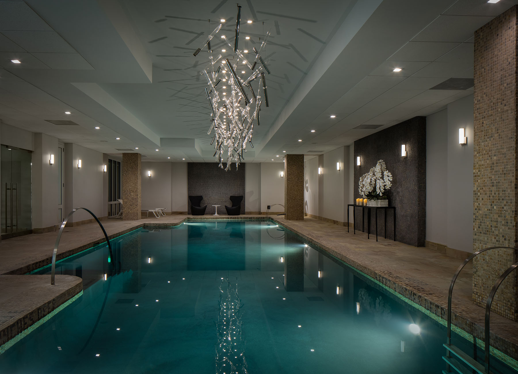 AKA Sutton Place indoor pool with chrome lighting and marble accents