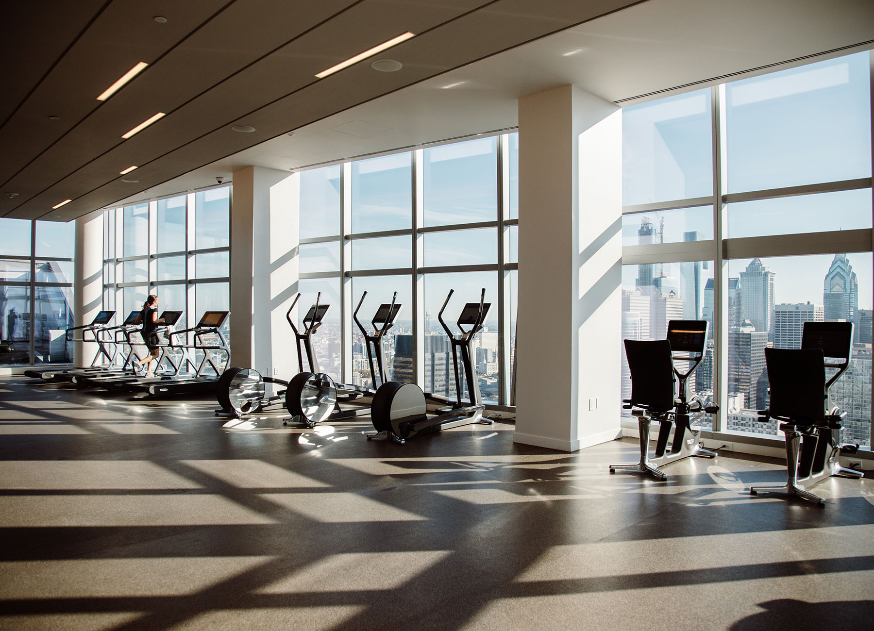 Fitness center with cardio equipment overlooking the Philadelphia skyline