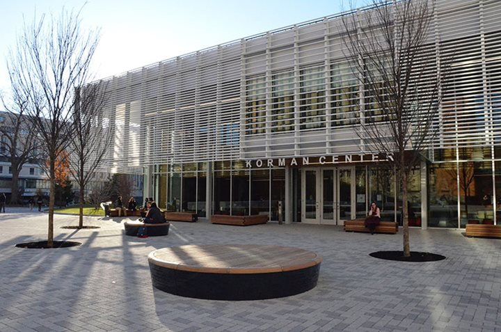 Korman Center Building on Drexel's campus with paved courtyard in front